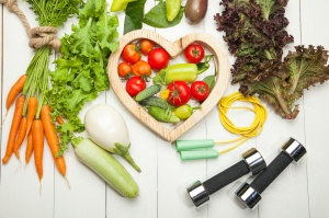 Healthy lifestyle concept. Eat fruits and vegetables and workout